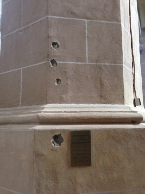 Bullet holes in the pillar of Brașov's famous Black Church remind citizens of the chaos of the 1989 revolution.